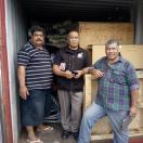 Container of disaster relief aid being unpacked in Tonga Small